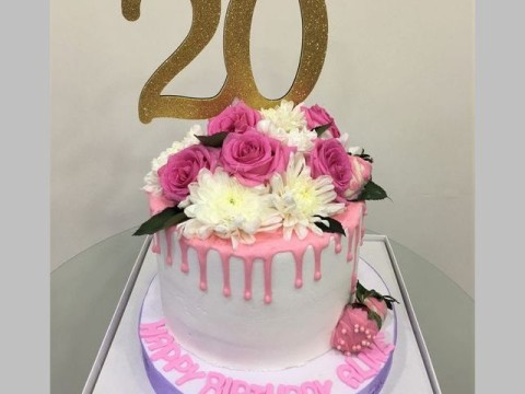 Pink on white floral cake