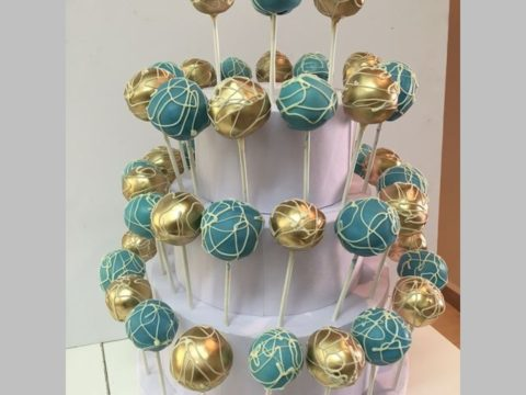Royal Gold Cake pops on a stand