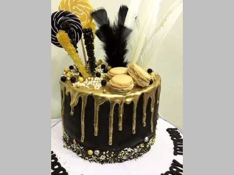 black cake with feather & gold dripping