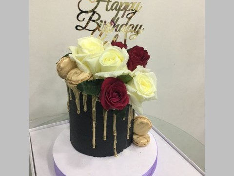Black gold dripping floral cake