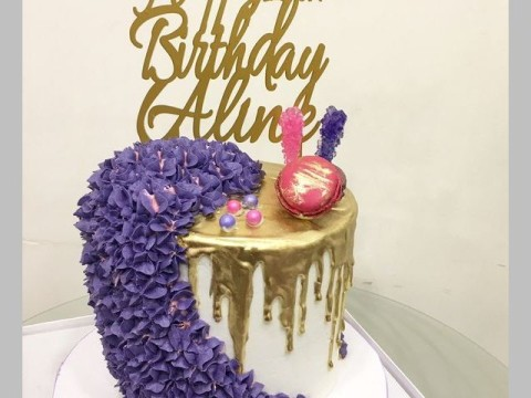 Gold dripped and purple flower cake