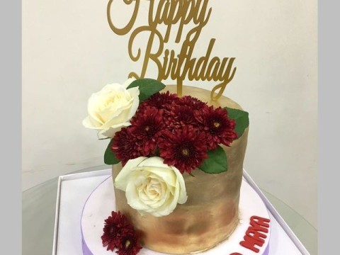 Red flowers on a gold cake