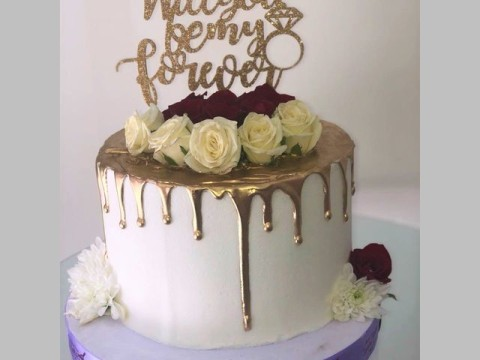 Propoasal gold dripping cake