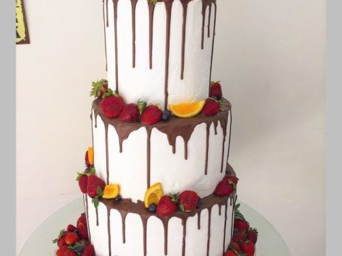 Layers of Cake Topped with fresh fruits