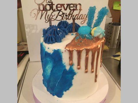 gold drip blue & white cake